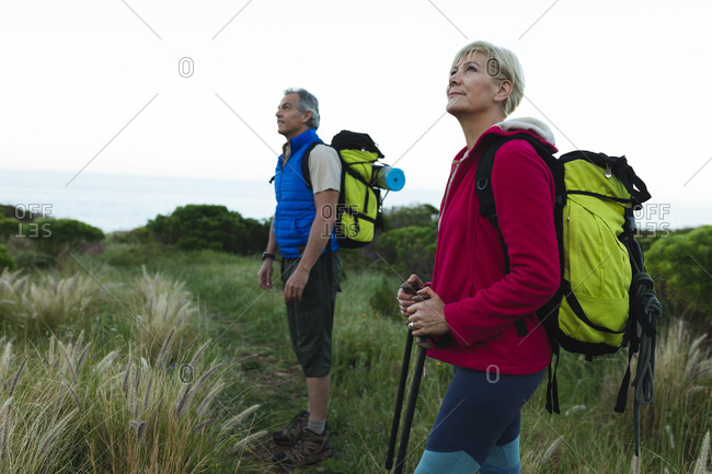 Senior caucasian couple admiring the view during hiking in nature. retirement active healthy lifestyle physical activity.