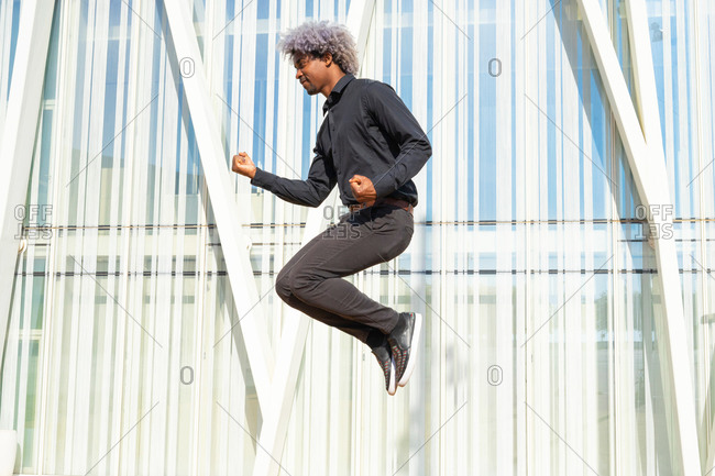 Afro and black businessman jumping and celebrating. celebration and emotion concept. victory and win.