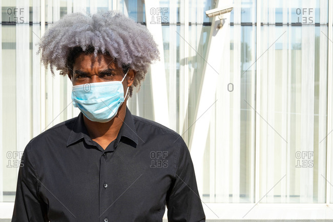 Afro and black businessman with a mask. concept of black man with mask. covid-19. social distancing.