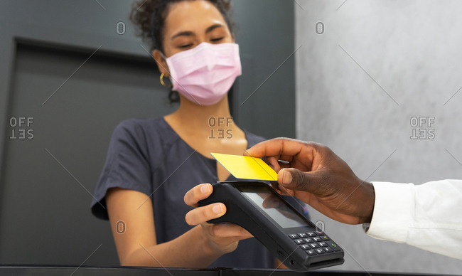 Low angle of african american female manager in medical mask