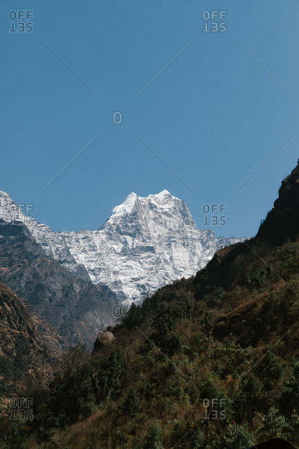 Majestic scenery of desert rough rocky mountainous terrain under blue sky in sunny day