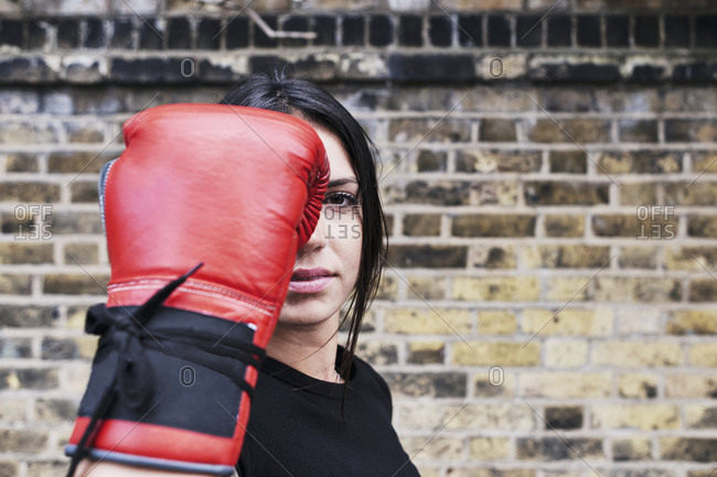 Portrait of young fighter with boxing gloves