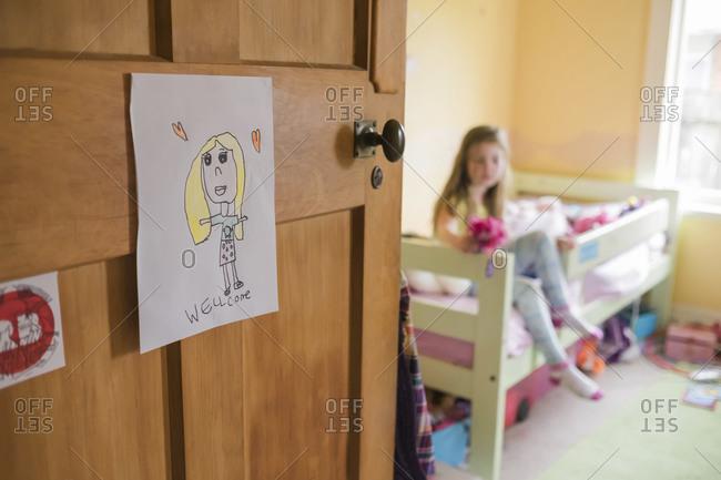 Hand drawn welcome sign on young girls bedroom door