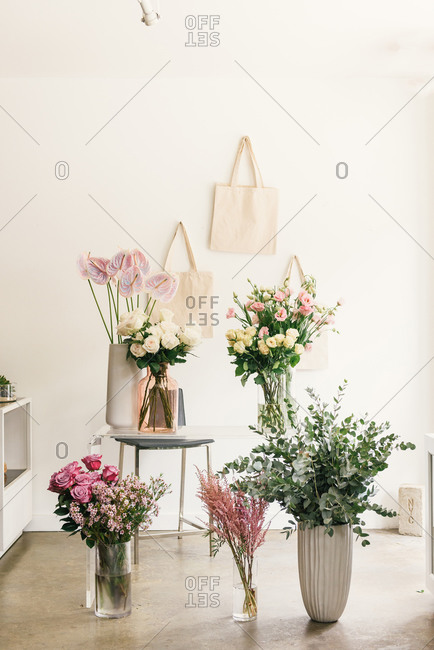 Beautiful collection of flower vases and stands inside florist shop