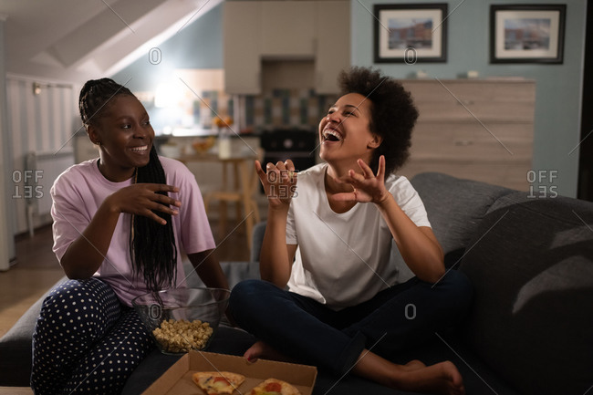 Happy diverse girlfriends having pizza party