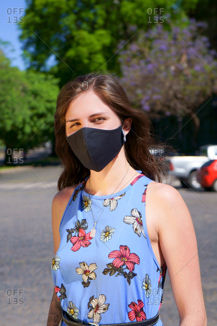 Woman outdoors during covid with mask