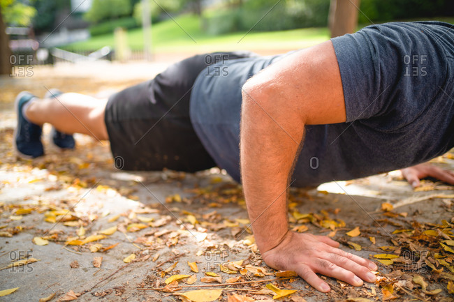 Unrecognizable man does push ups in a park during winter in Palma