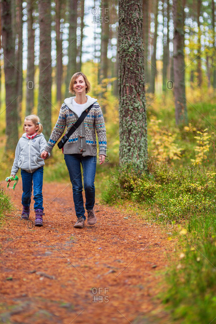 Mother and daughter on a woodland walk