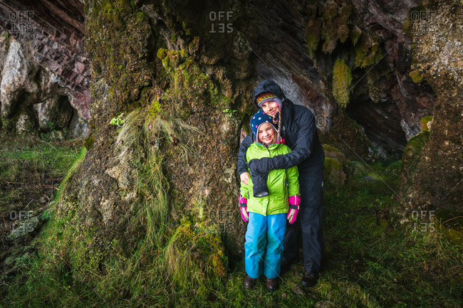 Mother and daughter taking shelter in a cave