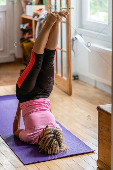 Woman doing an upside down yoga pose