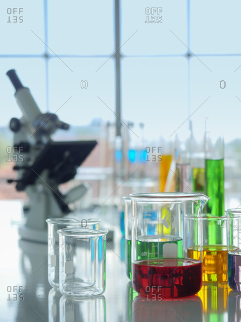 A group of beakers  and other lab equipment