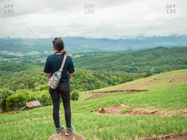 Woman at nice mountain range and valley view.