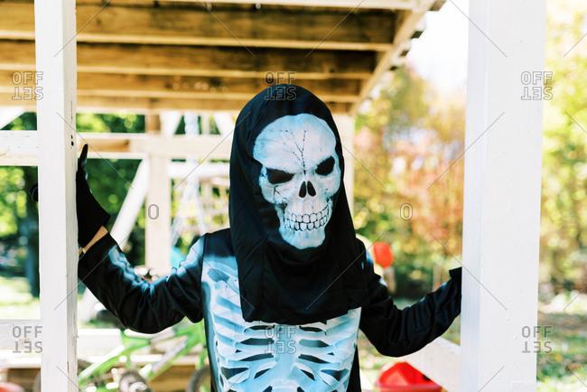 Little boy wearing a skeleton Halloween costume