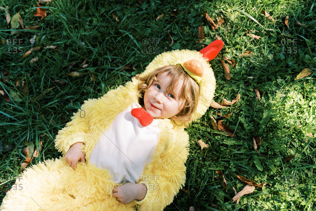 Little girl in chicken costume getting ready for trick or treating