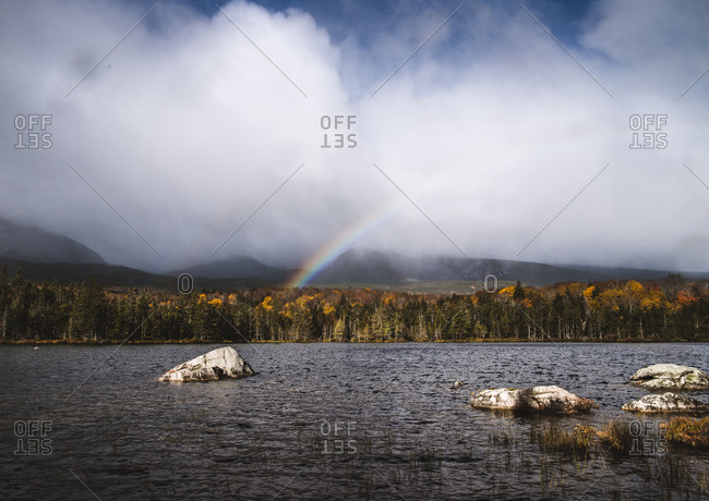 Rainbow forms over sandy stream pond, baxter state park, Maine