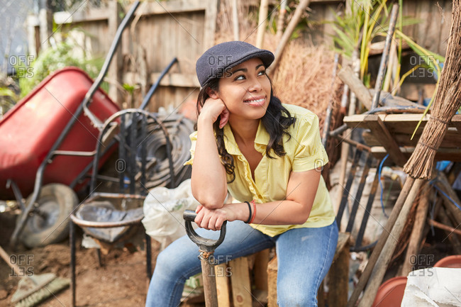 Young hipster woman taking a break after gardening