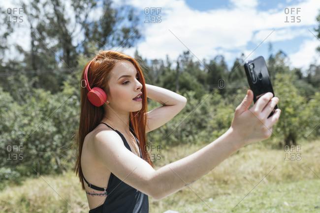 Cute red hair girl making a selfie