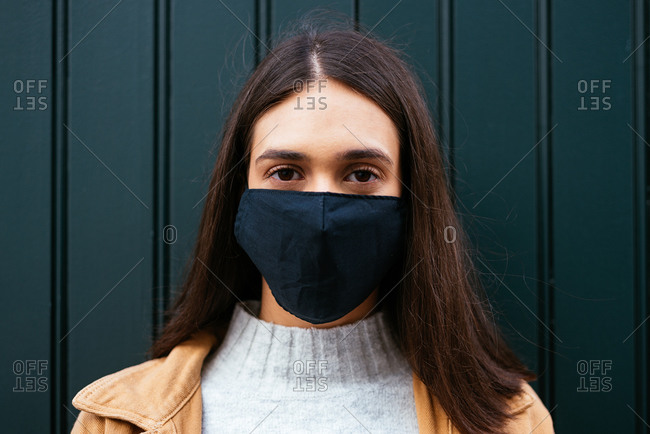 Portrait of a young woman wearing a face mask