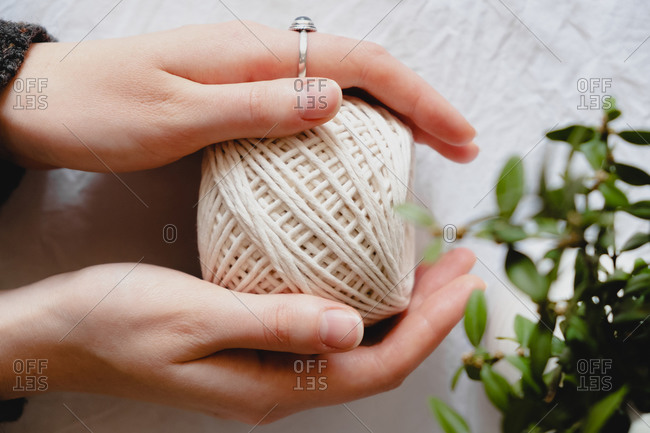 Roll of cotton ropes in woman hands.