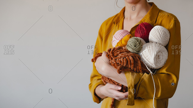 Rolls of cotton ropes in woman hand.