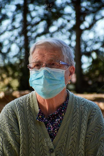 Portrait of an older woman wearing a mask
