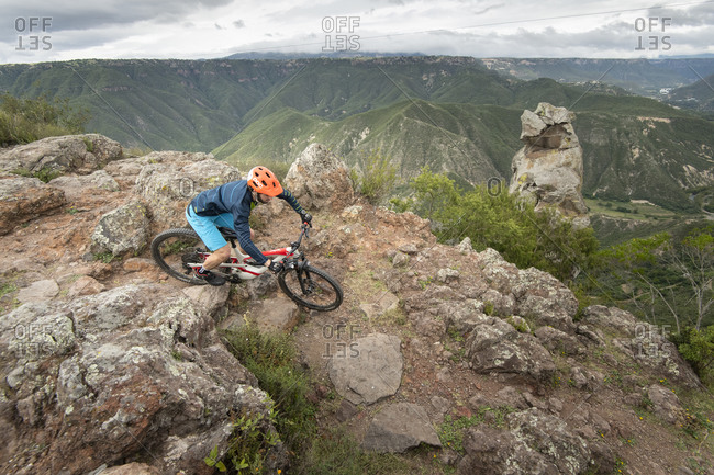 Mexico, Hidalgo, Huasca de Ocampo - September 29, 2018: One man riding a bike on a narrow rocky trail at Pena del Aire
