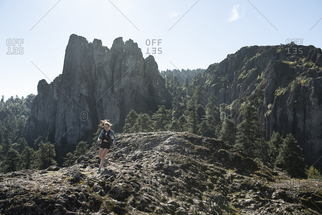 Mineral del Chico, Hgo., Mexico - September 30, 2018: One girl trail running down on a rocky terrain in the woods