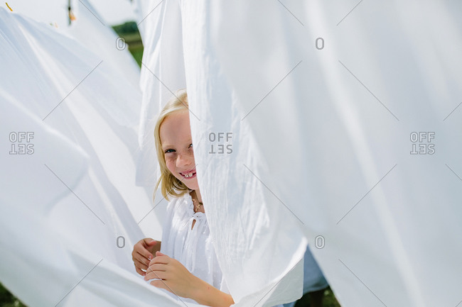 Little village girls playing hide and seek