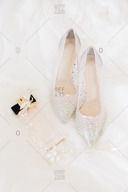 Bridal accessories. Bridal shoes, perfume and crown.