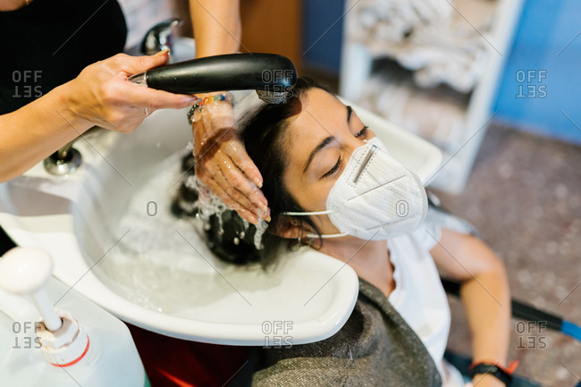 Woman in the hairdresser's washing her hair