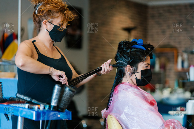 Woman in the hairdresser's cutting her hair