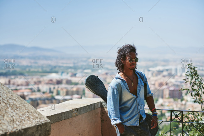 Portrait of young attractive man with dark skin. He is a musician from Latin America.