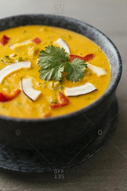 Home made vegan Thai curried red kuri squash soup with kale