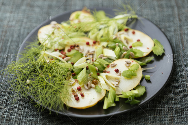 Plate with a home made pear, celery and fennel salad