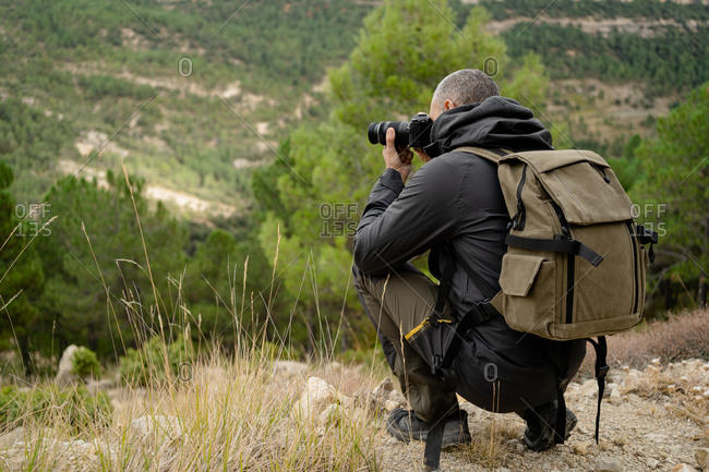 caucasian man Traveler with photo camera and backpack