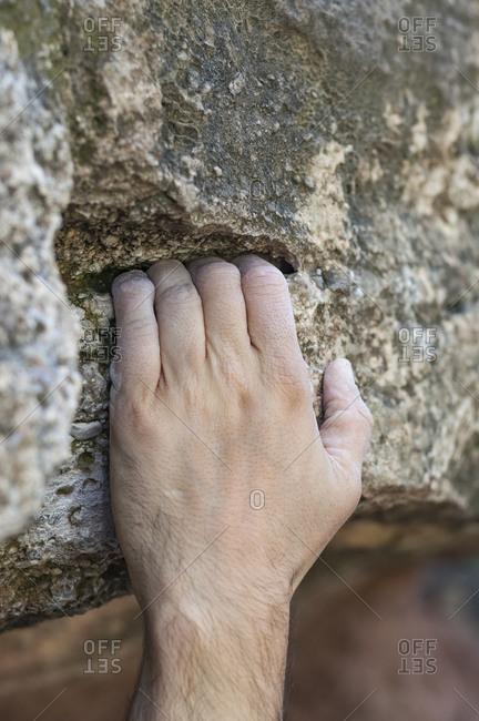 Climbing hand held to the stone.