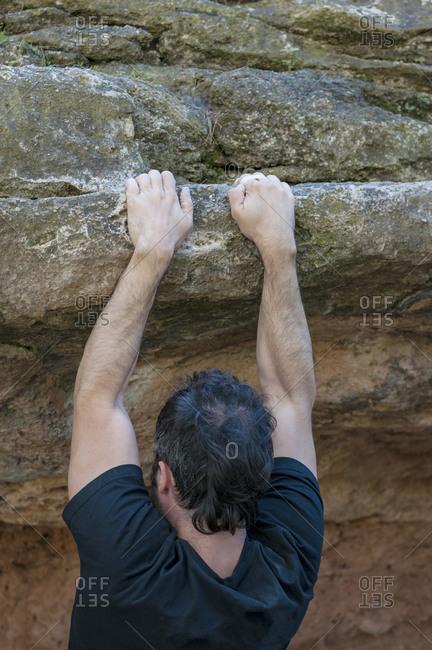 Climber trying to climb the rock.