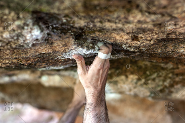 Tape fingers of a climber.