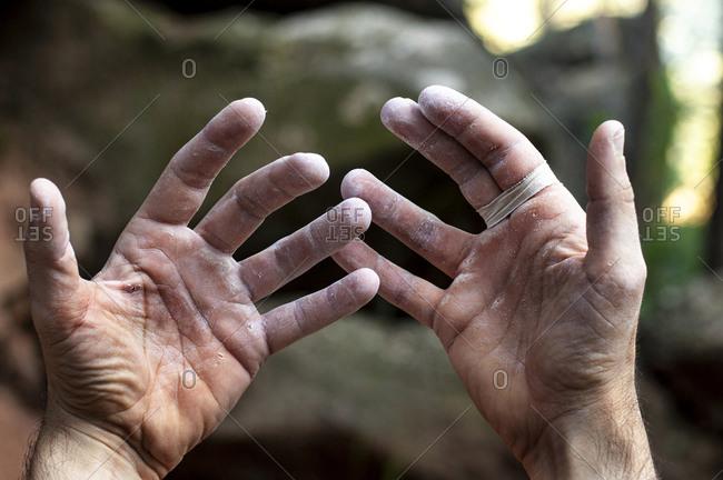 Climber hands, hard, after the effort.