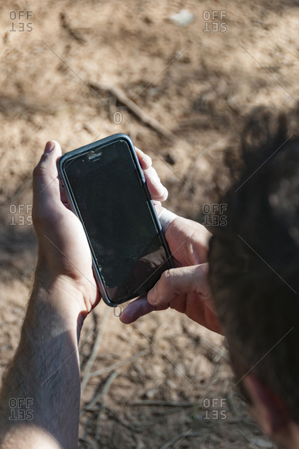 Climber looks at the mobile phone