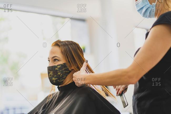 Woman in hair salon receiving hair treatment