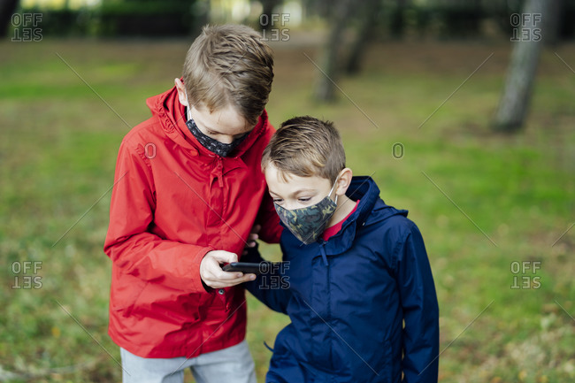 Children playing with their smartphone