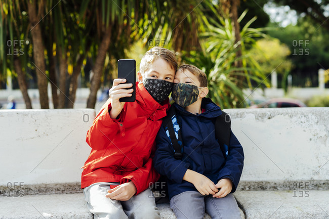 Children taking a picture with their smartphone