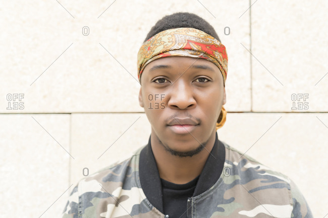 Portrait of young African man with headscarf