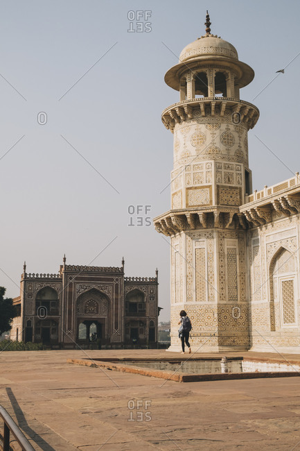 Young woman walking around the Tomb of Itmad-ud-Daula visiting in Agra, India