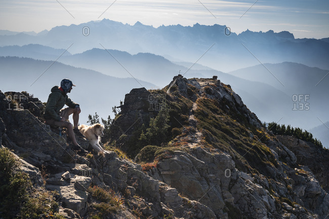 Wildfire Smoke In The North Cascades With Hiker and Dog on Summit