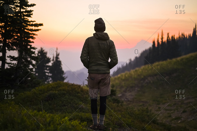 Male hiker watching sunset in the cascade mountain alpine