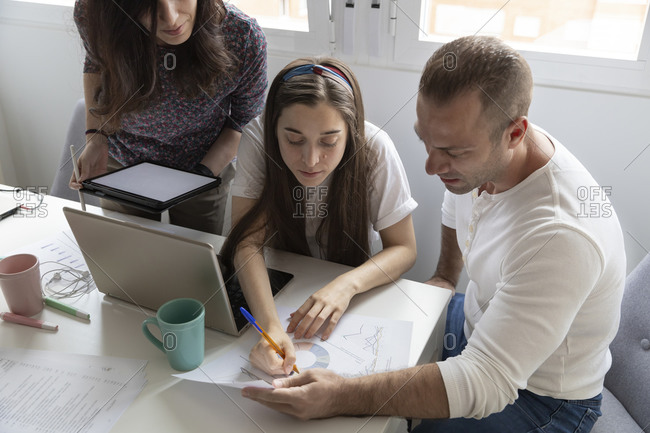Smart coworkers analyzing business report charts together