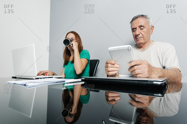 Telecommuting employees working with gadgets