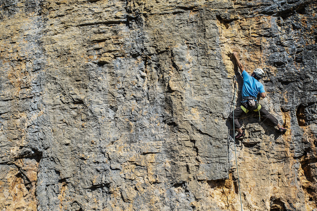 Frontal view of an unrecognizable climber in action